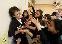 LOS ANGELES,CA - OCTOBER 6,2008: Bais Chaya Mushka School for Girls Teacher Elana Lackner hands out treats to eager Third Fourth and Fifth graders during a break in their jewish history lesson, October 6, 2008, at Chabad of California's school on 9051 West Pico Boulevard. Chabad is planning to expand their current K-12 school site on Pico to another city block next door. The new construction and expansion has troubled many neighbors who have banded together to oppose the effort. They say the proposal is too big, too high, and too dense.