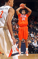Feb. 2, 2011; Charlottesville, VA, USA; Clemson Tigers forward/center Devin Booker (31) shoots over Virginia Cavaliers guard Mustapha Farrakhan (2)  during the game at the John Paul Jones Arena. Mandatory Credit: Andrew Shurtleff