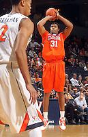 Feb. 2, 2011; Charlottesville, VA, USA; Clemson Tigers forward/center Devin Booker (31) shoots over Virginia Cavaliers guard Mustapha Farrakhan (2)  during the game at the John Paul Jones Arena. Mandatory Credit: Andrew Shurtleff
