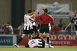 26 August 2011: Rochester's Tony Donatelli (21) and Harrisburg's Andrew Marshall (5) (behind, center) both earn red cards for fighting as Rochester's Isaac Kissi (GHA) (18) lays on the ground and Tyler Rosenlund (8) and referee Jose Carlos Rivero try to separate the players. The Harrisburg City Islanders defeated the Rochester Rhinos 2-1 in their USL PRO semifinal played at Sahlen's Stadium in Rochester, New York.