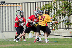 Los Angeles, CA 02/15/14 - Reid Marshall (USC #91) and unidentified Utah player(s) in action during the Utah versus USC game as part of the 2014 Pac-12 Shootout at UCLA.  Utah defeated USC 10-9.