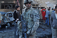 KIRKUK, IRAQ: American soldiers arrive in a Kirkuk neighborhood after a three car bombs went off...At 6 am, three car bombs detonated in the peaceful Kurdish neighborhood of Imam Kasimin Kirkuk.  There were 17 casualties.  Kirkuk is Iraq's most ethnically mixed city and is one month away from a volatile census that will determine the future of the city...Picture/ Ari Mohammad/Universal News And Sport (Europe) 6 November 2010.