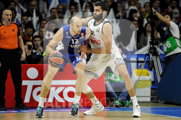Real Madrid´s Ioannis Bourousis and Anadolu Efes´s Nenad Krstic during 2014-15 Euroleague Basketball Playoffs match between Real Madrid and Anadolu Efes at Palacio de los Deportes stadium in Madrid, Spain. April 15, 2015. (ALTERPHOTOS/Luis Fernandez)