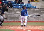 Wildcats' Austin Andrews hits against Utah State University Eastern at Western Nevada College in Carson City, Nev., on Saturday, April 25, 2015. <br /> Photo by Cathleen Allison