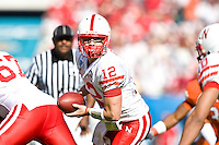 January 1, 2009:     Nebraska quarterback Joe Ganz (12) prepares to hand off to a running back first half game action in the 64th annual Konica Minolta Gator Bowl between the Nebraska Cornhuskers  and the Clemson Tigers  at Jacksonville Municipal Stadium in Jacksonville, Florida.