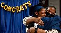 Jefferson County Public Schools broadcasts Iroquois High School's Virtual Graduation 2020 during the COVID-19 pandemic. <br /> <br /> Student Speaker Zo Simmons gets a hug after her graduation.