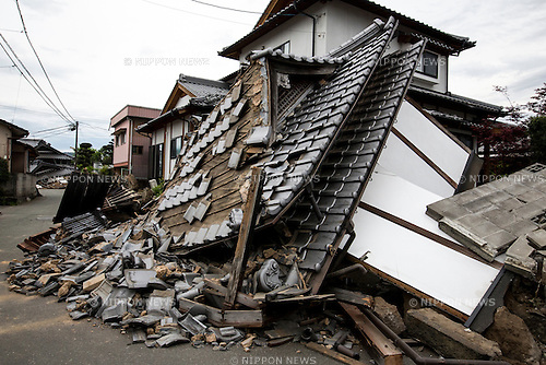 KUMAMOTO, JAPAN - APRIL 16: The roof of a house is left collapsed after a magnitude 7.3 earthquake hit Kyusyu Island on April 16, 2016 in Mashiki town, Kumamoto, Japan.The area was severely hit by a preliminary magnitude 6.5 quake Thursday night followed by magnitude 7.3 on Saturday morning. <br /> (Photo by Richard A. de Guzman/AFLO)
