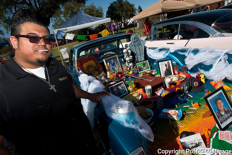 Francisco Beaz, 21, shows off his Day of the Dead display in the bed of his 1966 Ford Ranchero in October, 2012, during the Dia de los Muertos Festival at Mission San Luis Rey in Oceanside, California. photo for U-T San Diego