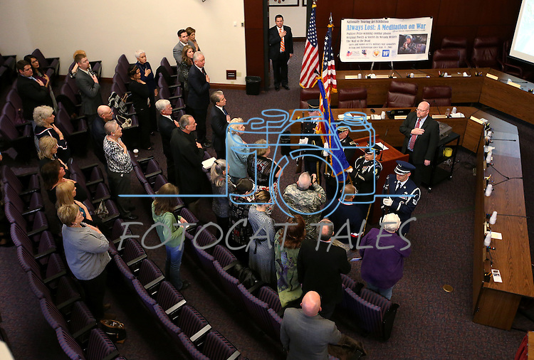 Nevada National Guard's joint color guard presents the colors during the opening ceremony of the Always Lost: A Meditation on War exhibit at the Legislative Building in Carson City, Nev., on Monday, April 6, 2015. <br /> Photo by Cathleen Allison/Nevada Photo Source