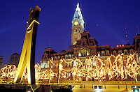 Philadelphia, City Hall, clothespin, Pennsylvania, PA, The Clothespin statue outside City Hall at Center Square decorated for the Christmas holidays in downtown Philadelphia in the evening.