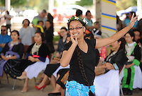 NWA Democrat-Gazette/ANDY SHUPE<br /> Rikrang Abitlom of Sprindale dances a traditional Marshallese dance Saturday, Sept. 19, 2015, during the Welcoming NWA: Celebrating the Cultural Diversity of Northwest Arkansas event at Shiloh Square in downtown Springdale. The event was organized by Engage NWA, a coalition of nonprofit organizations, businesses and community members, to celebrate National Welcoming Week.
