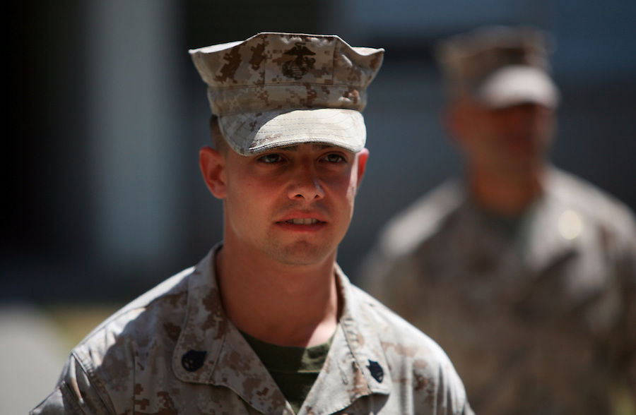 Staff Sgt. Frank Wuterich - leader of a squad of Marines accused of murdering 24 Iraqi civilians in the al-Anbar town, Haditha, on Nov. 19, 2005 - walks towards a courtroom at Camp Pendleton, CA on Thursday Sept. 6, 2007. Staff Sgt. Wuterich is accompanied by his lead defense attorney Neil Puckett.