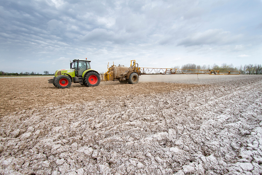 Applying liquid NPK fertilser to potato land - April, Lincolnshire