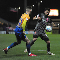 Lincoln City's Bruno Andrade vies for possession with Mansfield Town's Gethin Jones<br /> <br /> Photographer Andrew Vaughan/CameraSport<br /> <br /> The EFL Sky Bet League Two - Mansfield Town v Lincoln City - Monday 18th March 2019 - Field Mill - Mansfield<br /> <br /> World Copyright © 2019 CameraSport. All rights reserved. 43 Linden Ave. Countesthorpe. Leicester. England. LE8 5PG - Tel: +44 (0) 116 277 4147 - admin@camerasport.com - www.camerasport.com