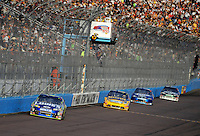 Nov. 9, 2008; Avondale, AZ, USA; NASCAR Sprint Cup Series driver Jimmie Johnson leads Jamie McMurray and Kurt Busch during the Checker Auto Parts 500 at Phoenix International Raceway. Mandatory Credit: Mark J. Rebilas-
