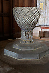 12th century stone font bowl with carved lozenge pattern, Ramsbury church, Wiltshire, England, UK