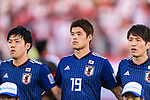 Endo Wataru (R), Sakai Hiroki (C) and Haraguchi Genki of Japan (R) listen to their national anthem prior to the AFC Asian Cup UAE 2019 Group F match between Oman (OMA) and Japan (JPN) at Zayed Sports City Stadium on 13 January 2019 in Abu Dhabi, United Arab Emirates. Photo by Marcio Rodrigo Machado / Power Sport Images