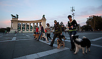 09 SEP 2010 - BUDAPEST, HUN - As dusk falls dog obedience class members put their pets through their paces in Heroes Square .(PHOTO (C) NIGEL FARROW)