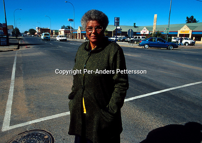 Ruth Mompati, the first black major walking in central Vryburg on June 19, 2001 Vryburg, South Africa. Vryburg, a small and very conservative farming town about 400 km west of Johannesburg has had a lot of high profile racist attacks since the democratic elections in 1994. A black boy is currently in prison after stabbing a white boy in Vryburg High School.The school has had a problem with  the integration of the black pupils in the former only white school. Some bars and restaurants are for whites only. South Africa is still battling racism and after seven years of a democraticly elected black government..Photo: Per-Anders Pettersson/ iAfrika Photos