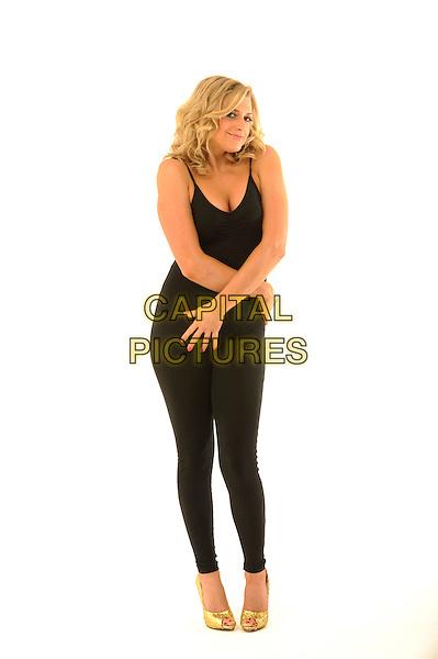 ANNA WILLIAMSON.TV Presenter Anna Williamson studio shoot, London, England..February 1st, 2011.full length black top leggings leotard hands gold shoes.CAP/FIN.©Steve Finn/Capital Pictures.