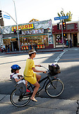 USA, Los Angeles, a woman and her son riding their bike down the street of Abbot Kinney Boulevard