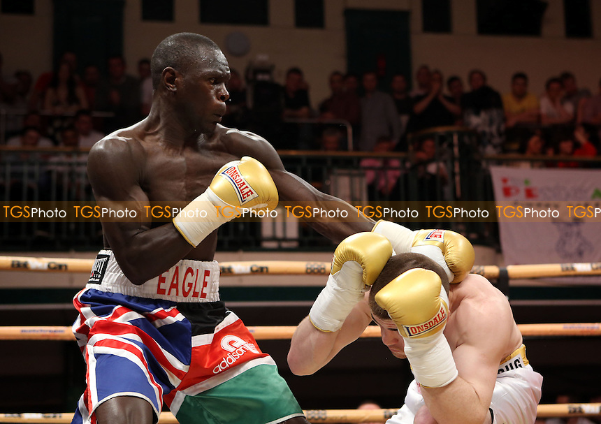 Erick Ochieng (multi coloured shorts) defeats Paddy Gallagher (white shorts) - Welterweights IV Prize Fighter Quarter Final - Boxing at York Hall, Bethnal Green, London - 05/04/14 - MANDATORY CREDIT: Rob Newell/TGSPHOTO - Self billing applies where appropriate - 0845 094 6026 - contact@tgsphoto.co.uk - NO UNPAID USE