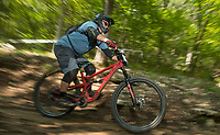 NWA Democrat-Gazette/BEN GOFF @NWABENGOFF<br /> James Watkins races Saturday, Aug. 18, 2018, during the Eureka Springs round of the Arkansas Enduro Series at Lake Leatherwood City Park. The event continues Sunday with stages at the Passion Play trails and an urban downhill leg through downtown Eureka Springs. The fifth and final race of the Arkansas Enduro Series season takes place Sept. 22 at the Coler Mountain Bike Preserve in Bentonville. Enduro is a type of mountain bike race with multiple time trial stages that are mostly downhill and technical. The downhill stages are linked together by untimed transition stages or shuttle buses.