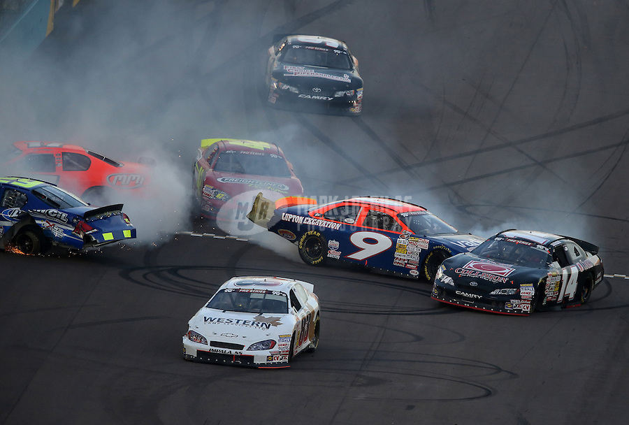 Mar. 2, 2013; Avondale, AZ, USA; NASCAR K&N Pro Series West driver Dylan Lupton (9) crashes into Travis Milburn (14) during the Talking Stick Resort 60 at Phoenix International Raceway. Mandatory Credit: Mark J. Rebilas-