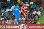 Getafe CF's Jorge Molina (l) and Atletico de Madrid's Lucas Hernandez during friendly match. August 11,2017. (ALTERPHOTOS/Acero)