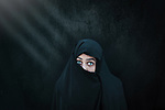 White face, green eyes and black cover. Photo by Sanad Ltefa