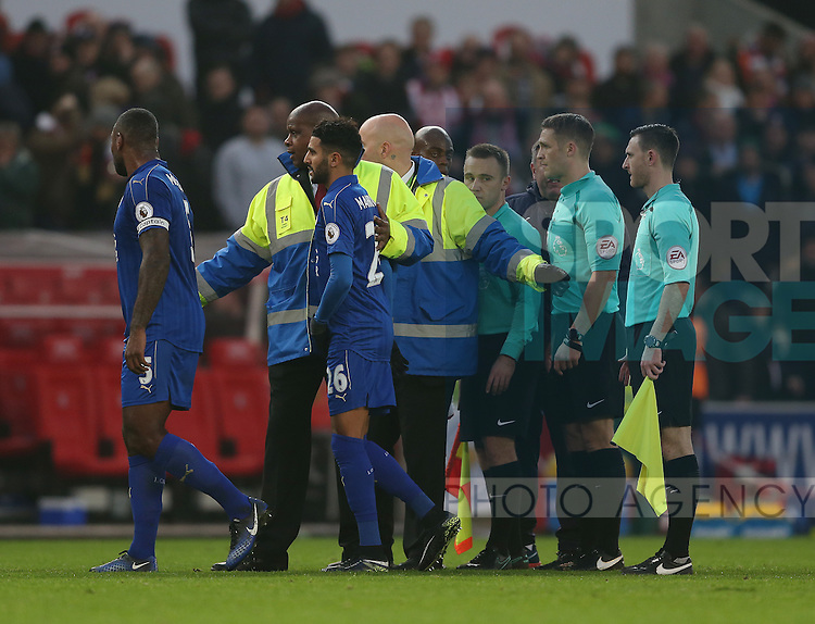 Stewards move the Leicester City players away from referee Craig Pawson at half time during the English Premier League match at the Bet 365 Stadium, Stoke on Trent. Picture date: December 17th, 2016. Pic Simon Bellis/Sportimage