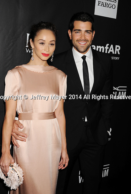 HOLLYWOOD, CA- OCTOBER 29: Actors Cara Santana (L) and Jesse Metcalfe attend amfAR LA Inspiration Gala honoring Tom Ford at Milk Studios on October 29, 2014 in Hollywood, California.