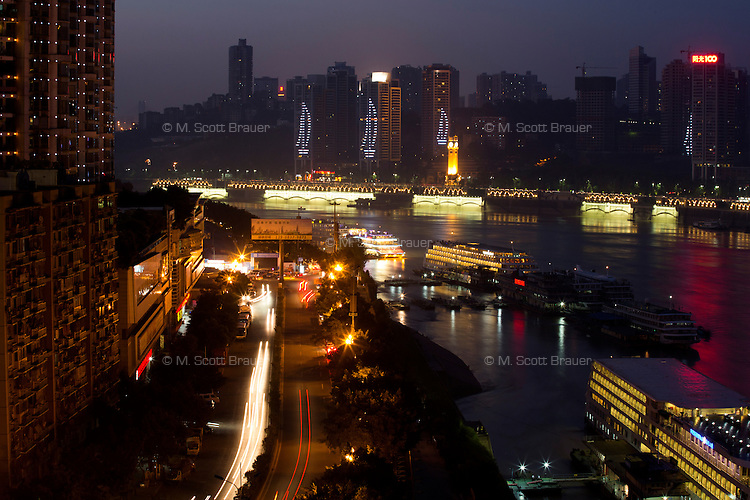 A view of Chongqing's skyline above riverboats on the Yangtze River in Chongqing, China.