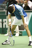 23-2-06, Netherlands, tennis, Rotterdam, ABNAMROWTT, Tim Henman stands defeated by the young chech Novak Djokovic