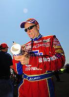 Apr 25, 2009; Talladega, AL, USA; NASCAR Sprint Cup Series driver Mark Martin signs autographs during qualifying for the Aarons 499 at Talladega Superspeedway. Mandatory Credit: Mark J. Rebilas-