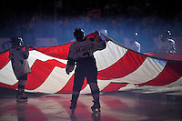 Junior Rampage hockey players hold an American flag during the national anthem before during an AHL hockey game between the San Antonio Rampage and the Houston Aeros, Sunday, Oct. 14, 2012, in San Antonio. San Antonio won 3-2. (Darren Abate/pressphotointl.com)