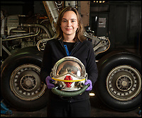 BNPS.co.uk (01202 558833)<br /> Pic: PhilYeomans/BNPS<br /> <br /> FAAM Curator Nicola Dowding​ with the helmet worn by Test Pilot Brian Trubshaw on Concorde's first British test flight.<br /> <br /> The space age helmet worn by Concorde test pilot Brian Trubshaw on the first ever UK flight has been reunited with the historic Concorde 002 at the Fleet Air Arm Museum in Somerset.<br /> <br /> The 50th anniversary of the flight on 9th April 1969 takes place tomorrow (Tuesday) when the Concorde prototype took off from Filton near Bristol with Trubshaw at the controls.<br /> <br /> The historic helmet was fitted with an oxygen supply in case of an depressurisation of the supersonic aircraft during testing and has been loaned to the museum by a collector.