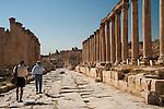 Steve walking down the road between the pillars in Jerash