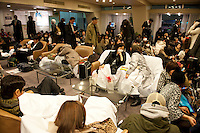 People stranded in the Prince Hotel, Shinagawa, Tokyo, 11 March 2011. After a huge earthquake in north-east Japan several million people in Tokyo struggle to return home.