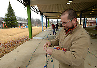 NWA Democrat-Gazette/ANDY SHUPE<br /> Nate Robinson, owner of the lighting company Lion Chasers in Springdale, assembles one of several long strands of lights Friday, Nov. 29, 2019, as he and his brother and father prepare to decorate the Christmas tree in Shiloh Square in downtown Springdale. The Downtown Springdale Alliance plans the Christmas on the Creak in Shiloh Square in downtown Springdale from 1-6 p.m. today that culminates in the lighting of the tree followed by the 23rd annual Rodeo of the Ozarks' Christmas Parade of the Ozarks at 6 p.m. along Emma Avenue.