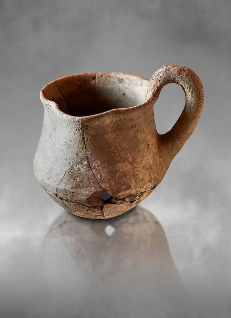 Hittite terra cotta cult side handled spouted jug. Hittite Period 1650 - 1450 BC, Ortakoy Sapinuvwa .  Çorum Archaeological Museum, Corum, Turkey. Against a grey bacground.