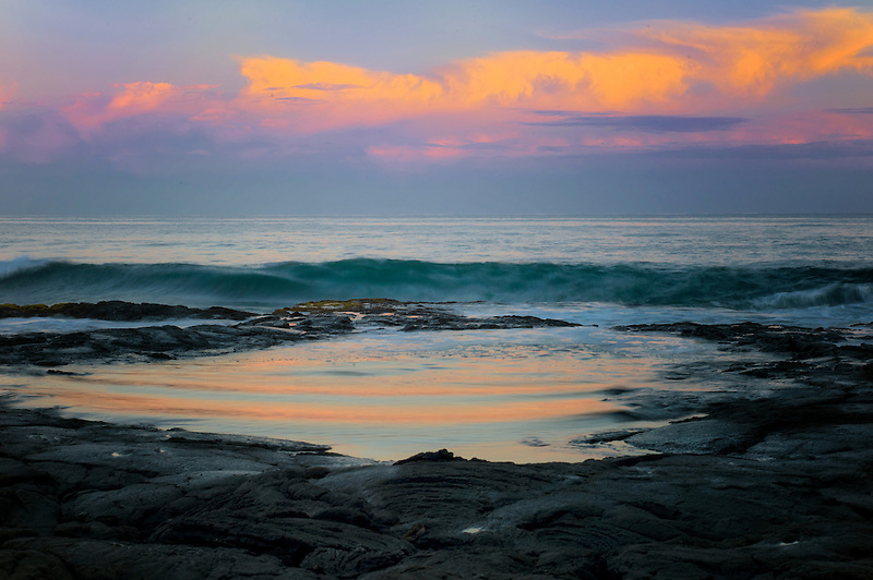 Tidepool reflection with sunrise. The Kohala Coast. The Big Island, Hawaii.