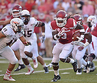 STAFF PHOTO BEN GOFF  @NWABenGoff -- 09/20/14 <br /> Arkansas running back Alex Collins carries the ball during the first quarter of the game against Northern Illinois in Reynolds Razorback Stadium in Fayetteville on Saturday September 20, 2014.