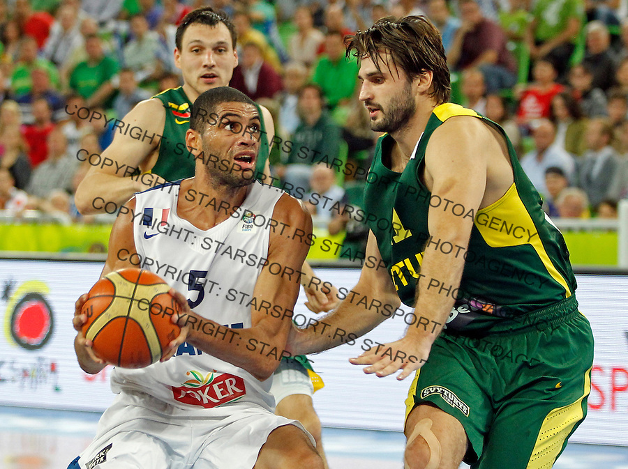 """France`s Nicolas Batum (L) and Jonas Klieza of Lithuania (R) in action during European basketball championship """"Eurobasket 2013""""  final game between France and Lithuania in Stozice Arena in Ljubljana, Slovenia, on September 22. 2013. (credit: Pedja Milosavljevic  / thepedja@gmail.com / +381641260959)"""