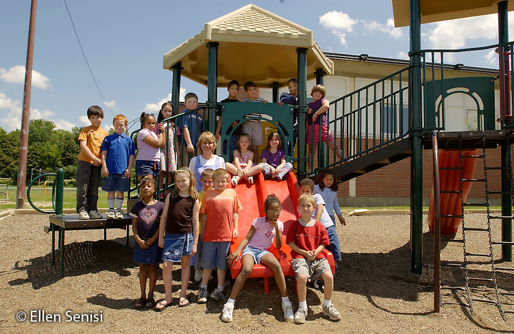 MR/Schenectady, NY.Yates Arts In Education Magnet School.Grade one/ two (split).Class picture on playground with students and teacher..Includes four mainstreamed students with special needs. Inclusion classroom contains four students with neurological disabilities..MR: L-C-1-2.©Ellen B. Senisi