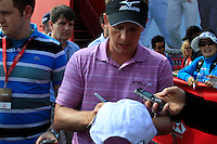 Luke Donald (ENG) signs autographs after finishing his match during Thursday's Round 1 of the HSBC Golf Championship at the Abu Dhabi Golf Club, United Arab Emirates, 26th January 2012 (Photo Eoin Clarke/www.golffile.ie)