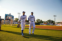 Byron Buxton (7) of the Chattanooga Lookouts and Miguel Sano (24) look on during a game between the Jackson Generals and Chattanooga Lookouts at AT&T Field on May 7, 2015 in Chattanooga, Tennessee. (Brace Hemmelgarn/Four Seam Images)