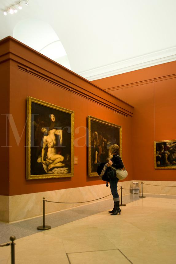 Woman enjoying Daniele Crespi painting called La Pieta, 1623, Prado Museum, Madrid, Spain
