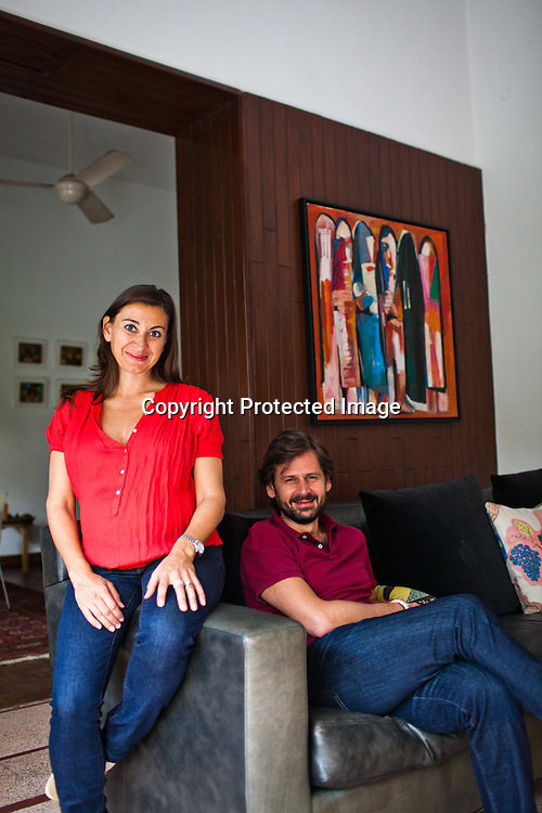 Award winning Photojournalist, Lynsey Addario poses for a portrait with her journalist husband, Paul de Bendern in their home in New Delhi, India. Photo: Sanjit Das