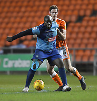 Blackpool's Ben Heneghan battles with Wycombe Wanderers' Adebayo Akinfenwa<br /> <br /> Photographer Dave Howarth/CameraSport<br /> <br /> The EFL Sky Bet League One - Blackpool v Wycombe Wanderers - Tuesday 29th January 2019 - Bloomfield Road - Blackpool<br /> <br /> World Copyright © 2019 CameraSport. All rights reserved. 43 Linden Ave. Countesthorpe. Leicester. England. LE8 5PG - Tel: +44 (0) 116 277 4147 - admin@camerasport.com - www.camerasport.com